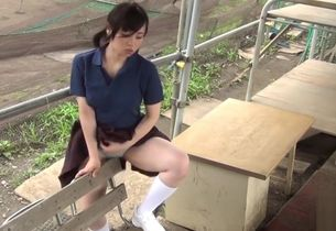 Asian female plumbing on the bench